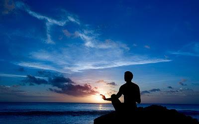 praying-on-ocean-cliff.jpg